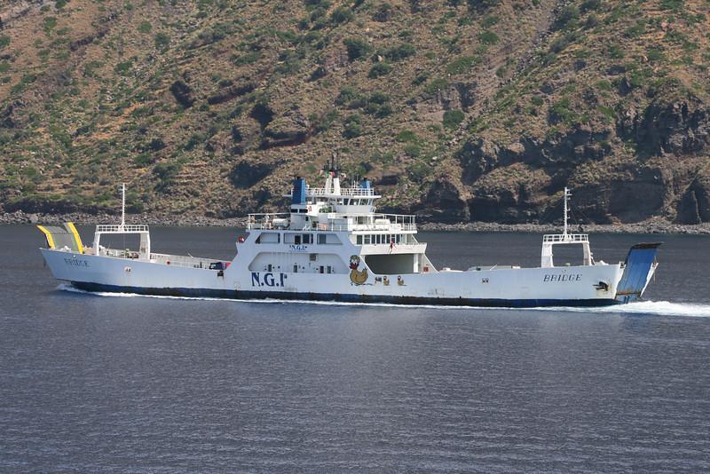 Two-way open deck ferry BRIDGE coasting Salina between Eolian islands.