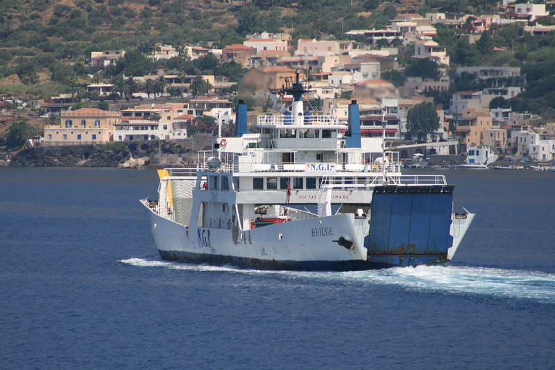 Two-way open deck ferry BRIDGE approachins Santa Marina Salina between Eolian islands.