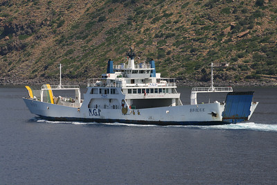 Two-way open deck ferry BRIDGE coasting Salina between Eolian islands.