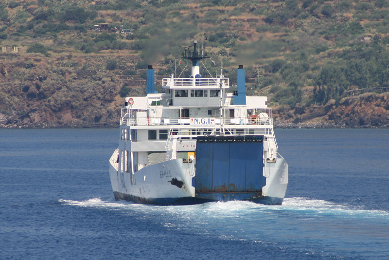 Two-way open deck ferry BRIDGE approachins Santa Marina Salina between Eolian islands.
