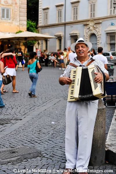 Street musician, Rome, Italy.
