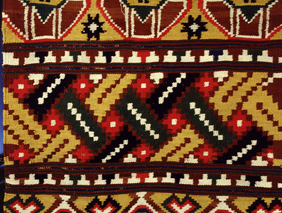 Double interlocked tapestries – rölakan.  Bench cover with wide borders and narrow repeated borders with T-shape (closeup detail). | Collection: Helsingborg museum, Sweden.