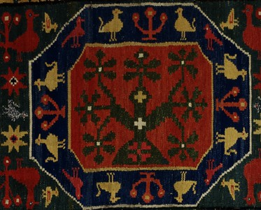 Double interlocked tapestries – rölakan. Supernatural horse/lion in octagonal frames, surrounded by stars, hearts etc (closeup detail, Tree). | Collection: Kulturen, Lund, Sweden.