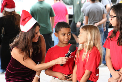KIII-TV News Anchor Katia Uriarte (from left to right), IWA fourth grader Jude Nerios-Ramsey, IWA fourth grader Katelyn Blaine, and IWA fifth grader Allie Salazar