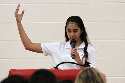 IWA sixth grader Isabella Brem recites a prayer on May 19 during a school Mass in honor of the Mother of God.