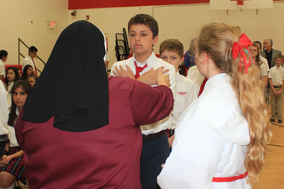 Sister Agueda Oviedo blesses IWA sixth grader Cade Bush during a school Mass on May 19. At the beginning of Mass.