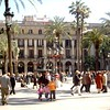 This is Plaça Reial.  It is near La Rambla. There is a beautiful fountain in the middle and some very nice restaurants.