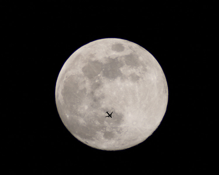 Airliner In Front of The Full Moon.  This image was featured in the Toronto Contact Exhibition.