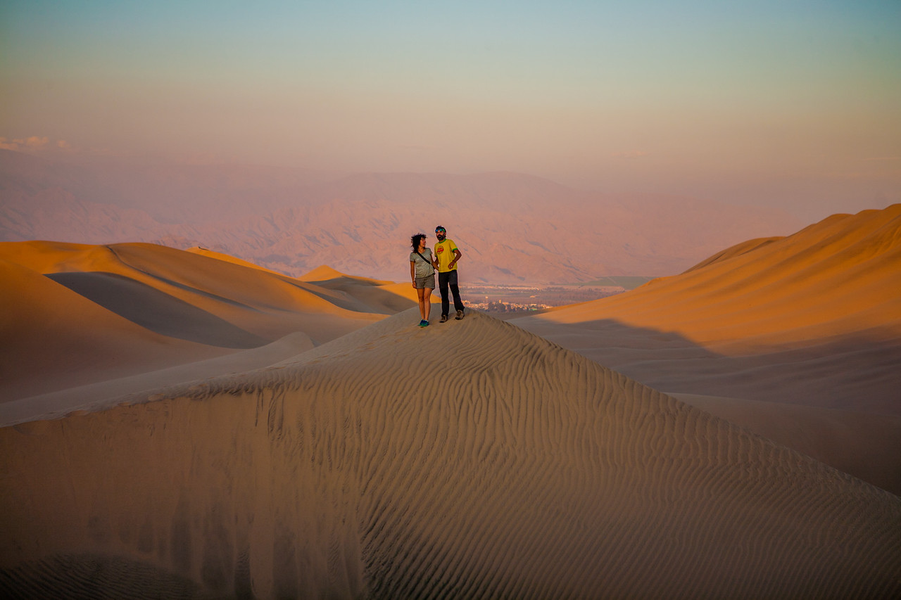 Sunset over the sand dunes of Huacachina near Ica, a city in Peru