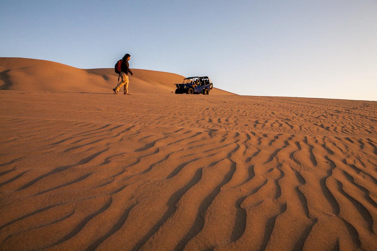 A walk over the desert of Huacachina near Ica, a city in Peru
