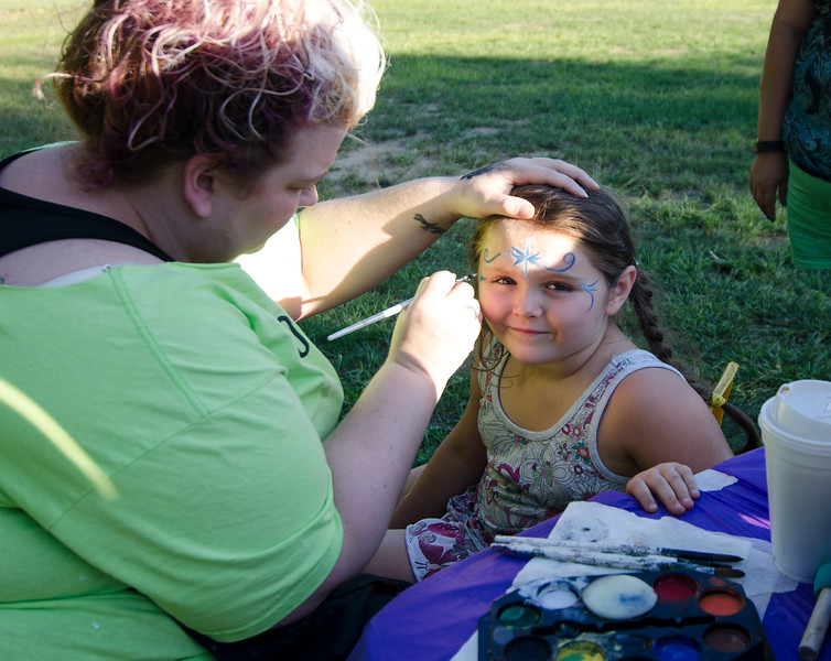 Helen Fissette gets her face painted by Stacey Murphy of Art on the Rocks during the ice cream social at Reingold Elementary School on Tuesday evening. SENTINEL & ENTERPRISE / Ashley Green