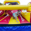 Lyla Girouard, going into 2nd grade, crawls through the bouncy house during the ice cream social at Reingold Elementary School on Tuesday evening. SENTINEL & ENTERPRISE / Ashley Green