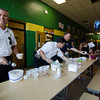 Fire Chief Kevin Roy scoops ice cream during the ice cream social at Reingold Elementary School on Tuesday evening. SENTINEL & ENTERPRISE / Ashley Green