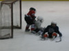 Nate (in Red with Red socks) blocking a goal. Sorry... the camera didn't focus in time... or focused on the glass