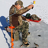 Tony Genova, 80 in foreground, of Townsend and his friend Bill Ferguson Jr., 79, of Lunenburg were enjoying themselves ice fishing on the Squannacook River Reservoir just off of Townsend Road in Groton on Friday morning December 23, 2016. SUN/JOHN LOVE