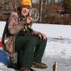 Bill Ferguson Jr.,79, of Lunenburg was enjoying himself ice fishing on the Squannacook River Reservoir just off of Townsend Road in Groton on Friday morning December 23, 2016. SUN/JOHN LOVE