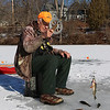 Bill Ferguson Jr.,79, of Lunenburg was enjoying himself ice fishing on the Squannacook River Reservoir just off of Townsend Road in Groton on Friday morning December 23, 2016. Ferguson holds up a fish he just caught. SUN/JOHN LOVE