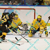 During the 2011 West Regional finals at Scottrade Center in St. Louis, Missouri.  Colorado center Nick Dineen (22) looks to get a shot on goal against Michigan center Matt Rust (19) and goalie Shawn Hunwick (31).  Michigan held on to defeat Colorado 2 to 1 to advance to the frozen four.