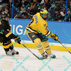 During the 2011 West Regional finals at Scottrade Center in St. Louis, Missouri.  Michigan left winger Scooter Vaughan (3) skates around Colorado defenseman Eamonn McDermott (7) on his way to scoring the games first goal.  Michigan held on to defeat Colorado 2 to 1 to advance to the frozen four.