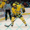 During the 2011 West Regional finals at Scottrade Center in St. Louis, Missouri.  Michigan right winger A.J. Treais gets ready to dump the puck into the Colorado zone.  Michigan held on to defeat Colorado 2 to 1 to advance to the frozen four.