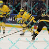 During the 2011 West Regional finals at Scottrade Center in St. Louis, Missouri.  Michigan defenseman Leff Moffie (13) passes the puck while being defended by Colorado defenseman Ryan Lowery (24).  Michigan held on to defeat Colorado 2 to 1 to advance to the frozen four.