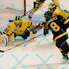During the 2011 West Regional finals at Scottrade Center in St. Louis, Missouri.  Colorado left winger Jaden Schwartz (8) gets a shot off the is stopped by Michigan goalie Shawn Hunwick (31) while left winger Ben Winnett (16) attempts to defend.  Michigan held on to defeat Colorado 2 to 1 to advance to the frozen four.