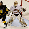 During the 2011 West Regional playoffs at Scottrade Center in St. Louis, Missouri.  Boston goalie John Muse (1) looks around the screen of Colorado center Nick Dineen (22).  Colorado College controlled the game as they defeated Boston College 8 to 4 to advance to the West Regional finals.