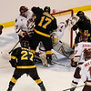 During the 2011 West Regional playoffs at Scottrade Center in St. Louis, Missouri.  Players from both teams converge on the net as Colorado attempts to stuff the puck into the Boston goal.  Colorado College controlled the game as they defeated Boston College 8 to 4 to advance to the West Regional finals.