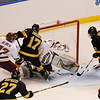 During the 2011 West Regional playoffs at Scottrade Center in St. Louis, Missouri.  Colorado right winger Tyler Johnson (17) attempts to stuff the puck past Boston goalie John Muse (1) while being defended by defenseman Patch Alber (24)  Colorado College controlled the game as they defeated Boston College 8 to 4 to advance to the West Regional finals.