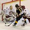 During the 2011 West Regional playoffs at Scottrade Center in St. Louis, Missouri.  Colorado center Rylan Schwartz (13) attempts to put a rebound past Boston goalie John Muse (1) while being defended by defenseman Edwin Shea (8).  Colorado College controlled the game as they defeated Boston College 8 to 4 to advance to the West Regional finals.