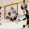 During the 2011 West Regional playoffs at Scottrade Center in St. Louis, Missouri.  Colorado right winger center Rylan Schwartz (13) fires the puck into the net past the defense of center Pat Mullane (11) and goalie John Muse (1).  Colorado College controlled the game as they defeated Boston College 8 to 4 to advance to the West Regional finals.