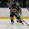 During the 2011 West Regional playoffs at Scottrade Center in St. Louis, MO.  Nebraska-Omaha center Joey Martin (14) looks to make a pass in the offensive zone.  Michigan defeated Nebraska 3 to 2 with a goal in overtime that had to be determined via a video review to advance to the West Regional finals.