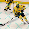 During the 2011 West Regional playoffs at Scottrade Center in St. Louis, MO.  Michigan defenseman Greg Pateryn (2) breaks the puck out of his own zone.  Michigan defeated Nebraska 3 to 2 with a goal in overtime that had to be determined via a video review to advance to the West Regional finals.