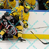 During the 2011 West Regional playoffs at Scottrade Center in St. Louis, MO.  Nebraska-Omaha left winger Ryan Walters (19) attempts to tie up Michigan defenseman Jon Merrill (24).  Michigan defeated Nebraska 3 to 2 with a goal in overtime that had to be determined via a video review to advance to the West Regional finals.