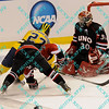During the 2011 West Regional playoffs at Scottrade Center in St. Louis, MO.  Michigan right winger Luke Glendening (23) drives around a Nebraska-Omaha defender while attempting to put a back handed shot past Nebraska-Omaha goalie John Faulker (30).  Michigan defeated Nebraska 3 to 2 with a goal in overtime that had to be determined via a video review to advance to the West Regional finals.