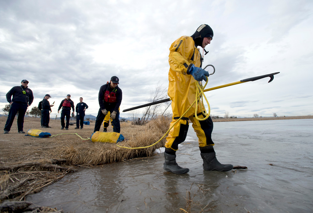 . BOULDER, CO - JANUARY 10, 2019: North Metro Fire Rescue Firefighter Todd Field walks out onto the ice to search for a simulated body while training in ice rescue operations on Thursday at Stearns Lake in Broomfield. For more photos of the training go to dailycamera.com (Photo by Jeremy Papasso/Staff Photographer)