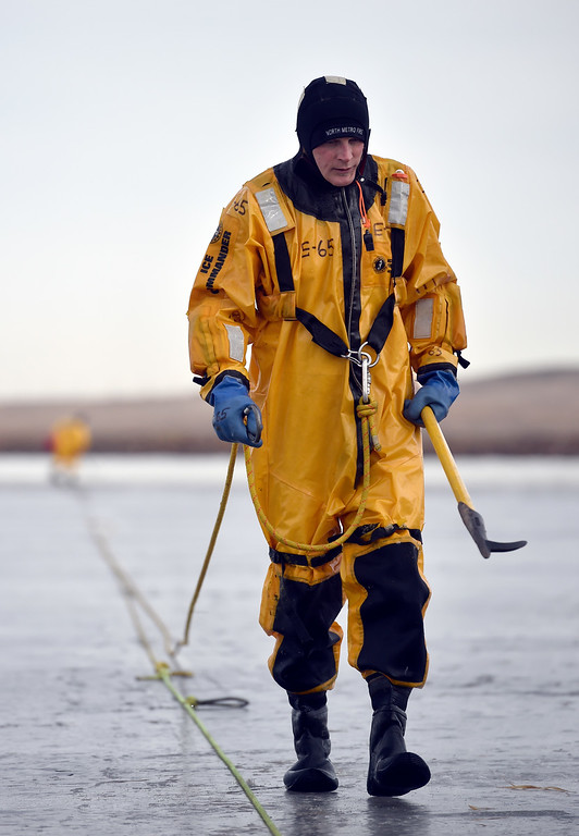 . BOULDER, CO - JANUARY 10, 2019: North Metro Fire Rescue Firefighter Todd Field walks back towards shore while training in ice rescue operations on Thursday at Stearns Lake in Broomfield. For more photos of the training go to dailycamera.com (Photo by Jeremy Papasso/Staff Photographer)