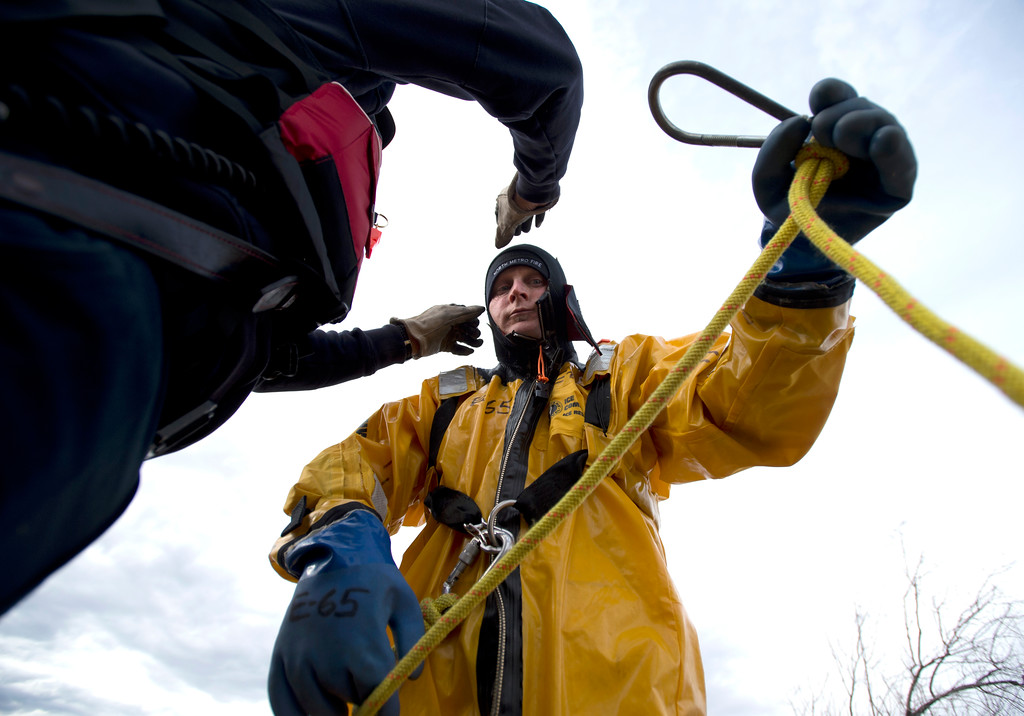 . BOULDER, CO - JANUARY 10, 2019: North Metro Fire Rescue Firefighter Todd Field prepares his rescue rope while training in ice rescue operations on Thursday at Stearns Lake in Broomfield. For more photos of the training go to dailycamera.com (Photo by Jeremy Papasso/Staff Photographer)