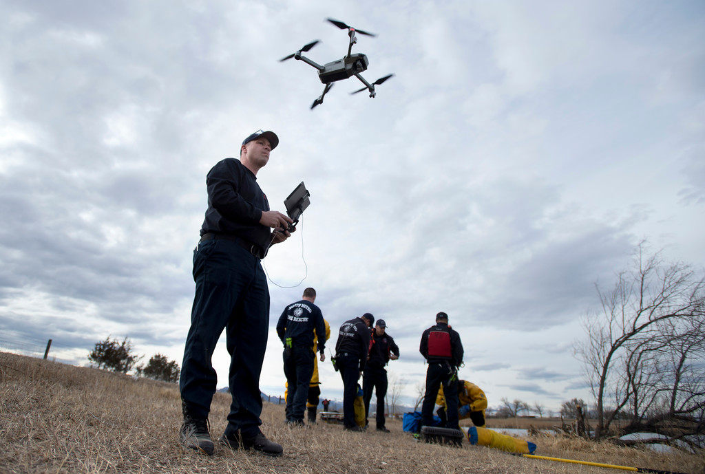 . BOULDER, CO - JANUARY 10, 2019: North Metro Fire Rescue Firefighter Jeff Burke flies a drone towards an area of the frozen lake while training in ice rescue operations on Thursday at Stearns Lake in Broomfield. For more photos of the training go to dailycamera.com (Photo by Jeremy Papasso/Staff Photographer)