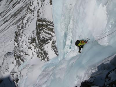 "Jeff Relph nearing the top of ""Murchinson Falls"" WI4+"