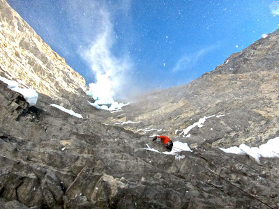 Jonny drilling the second bolt of the route in one of many spindrifts