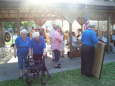 photo by Jon Morgan  A crowd gathered in the space between the Shepherd Park and the Powerhouse Museum to listen to the Central Michigan Area Community Band Monday night during the Shepherd Area Historical Society's annual Ice Cream Social. Cake, ice cream, and other treats were served inside the museum. SAHS president Larry Noyes also gave tours through the museum.  Proceeds from the event went towards the Shepherd Area Historical Society.