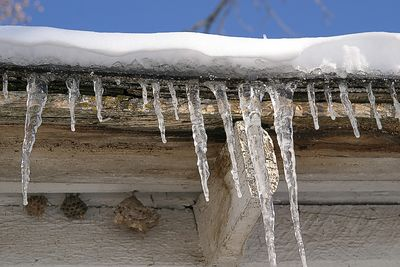 Taken with my Tamron 28-75 f/2.8 Lens, Icecycles on my roof Edge. I even got some Wasp Nests in. Haha!