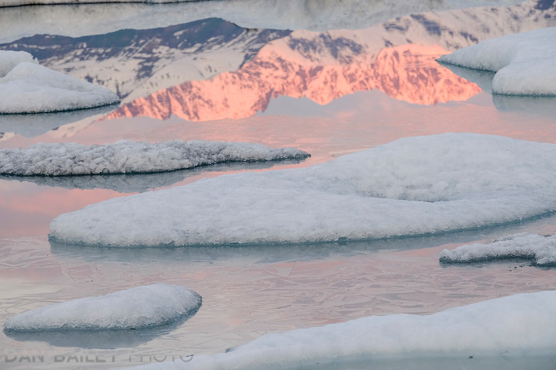 Susnet views of the Knik Glacier lagoon and the Chugach Mountains, Alaska