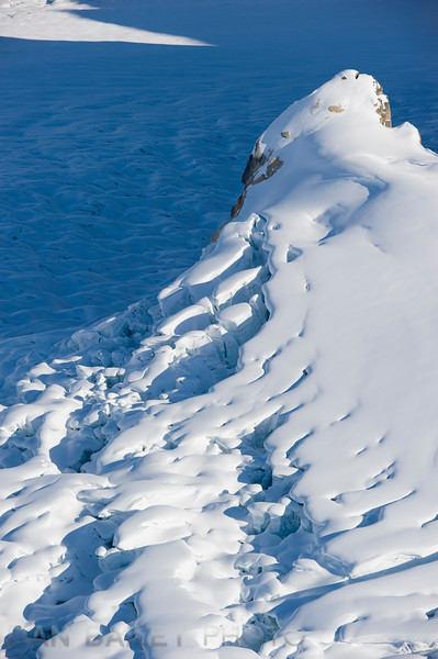 Mountain spire with an glacial icefall, Ruth Amphitheater, Alaska Range, Denali National Park, Alaska