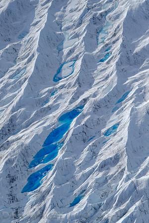 Aerial photo of meltwater pools on the Knik Glacier, Chugach Mountains, Alaska