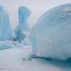 Frozen iceberg on the Knik Glacier Lagoon, Chugach Mountains, Alaska.
