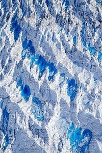 Aerial photo of meltwater pools on the Knik Glacier, Chugach Mountains, Alaska