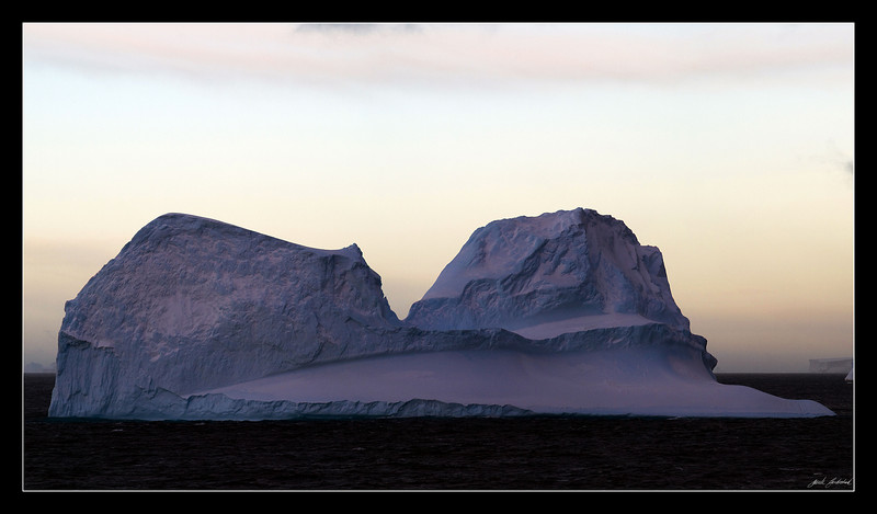 Olympus E-510 ZD 40-150mm f/4.0-5.6 @ 150mm<br /> <br /> The sun has just set, giving this iceberg a pinkish glow...
