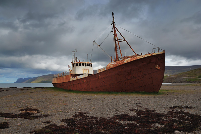 Old rusting fishing boat at Osafjordur, Latrabjarg Peninsula.